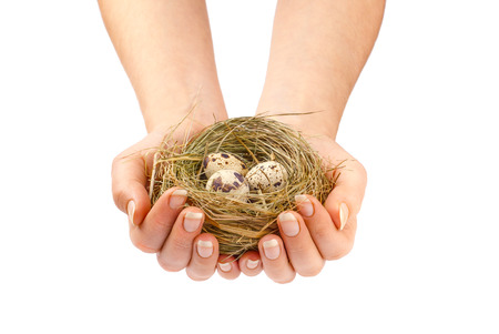 birdnest: Young woman holding birds nest over white background