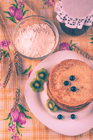 shrove: Vintage picture. Ukrainian pancakes on Shrove Tuesday. Stock Photo
