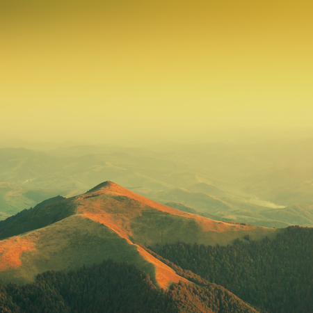 Evening in a Carpathian mountain valley. Warm vintage colors