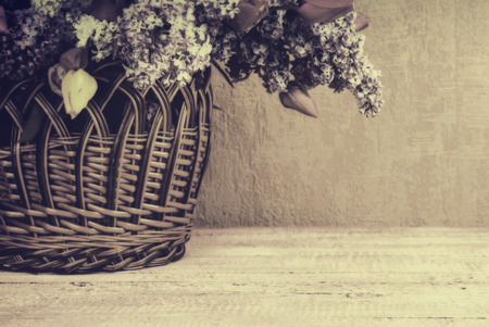 basket: Basket with lilac and tulips. Vintage colors Stock Photo