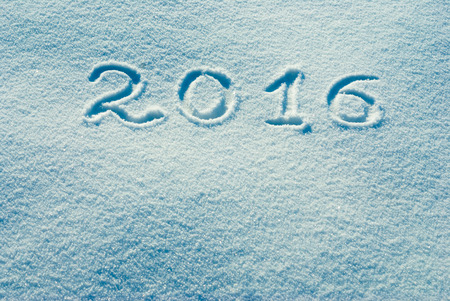 Christmass and New Year background. 2016 written on a snow Stock Photo