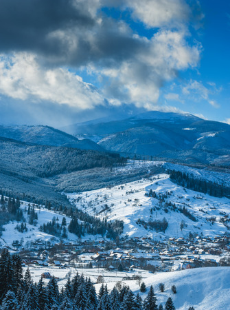 sheepfold: Panorama of Carpathian mountain valley covered by fresh snow. Sunny winter day. Ukraine, Europe