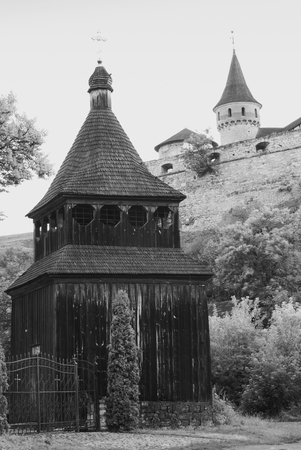 dome of the rock: Old wooden church of the Exaltation of the Cross is in the town Kamianets-Podilskyi under walls of the old castle. Ukraine. Monochrome colors