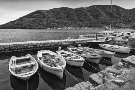 Boats in a sea bay of Perast village, the famous tourist centre in Montenegro, Europe. 版權商用圖片