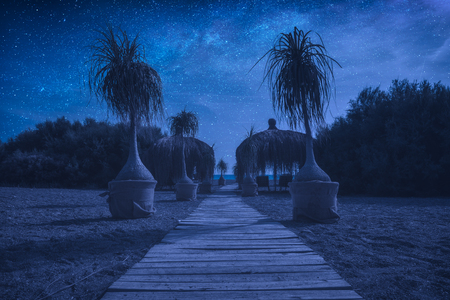 The path to the Cirali beach at night with milky way in a starry sky. Mediterranean sea coast, Turkey, lycia.