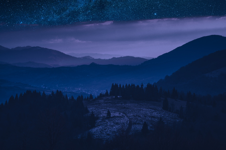 Colorful night in a carpathian mountain valley with beautiful moonlight. 版權商用圖片