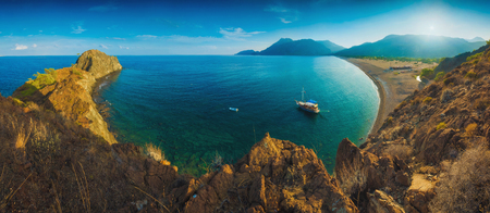 Panorama of Cirali beach and Olimpos mountain in evening light. Kemer, Antalya, Mediterranean region, Turkey, Lycia. 版權商用圖片