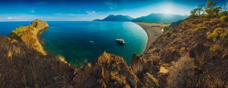 Panorama of Cirali beach and Olimpos mountain in a sunset light. Kemer, Antalya, Mediterranean region, Turkey, Lycia. 版權商用圖片 - 121116457