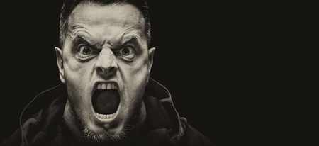 Angry scarry shouting man on a black background with place for text. Vintage sepia stylization. Banque d'images - 121116460