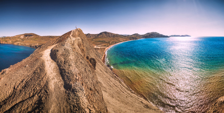 Panorama of Chameleon cape on a Black sea coast in Crimea. Unbelievable colors in a water that looks so fantastic due to soil erosion.