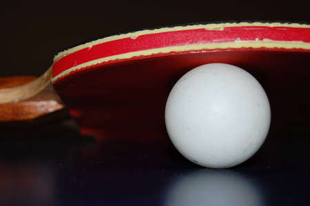 table tennis ball and paddle. Stock Photo
