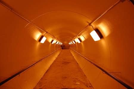 Illuminated underground tunnel.