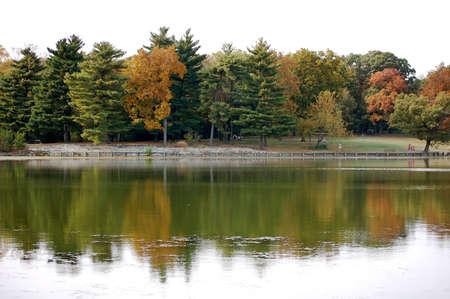 Lake reflecting Autumn colored trees. Stock Photo