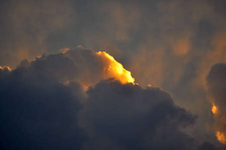 Golden spot on storm clouds. Stock Photo - 9644520