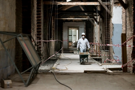 Worker during renovation building photo