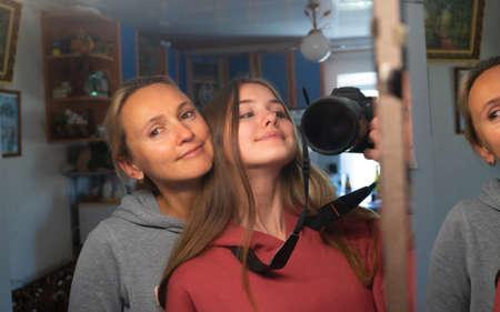 Smiling family mother and daughter makes selfie 版權商用圖片
