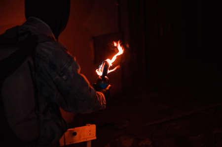 Protester burn molotovs cocktail preparing to throw