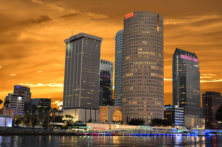 Tampa, Florida. October 06, 2018. Downtown Skyscrapers with colorful illuminated dockside on beautiful sunset.