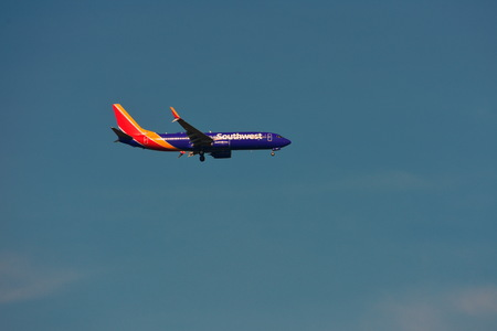 Orlando, Florida. September 6,2018. Airplane from Southwest Airlines, is landing at Orlando Airport on beautiful blue sky backround.