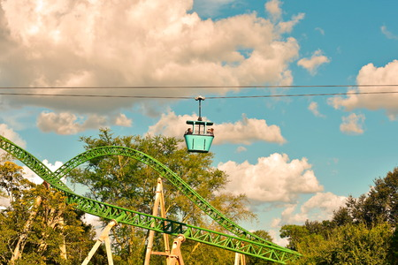 Tampa, Florida; September 29, 2018 Couple enjoying Skyride attraction. Panoramic view of Cheetah Hunt and beautiful forest on blue cloudy sky at Bush Gardens