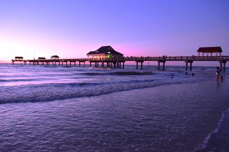 Clearwater, Florida. October 21,2018 Panoramic view of Pier 60 on magenta sunset background at Cleawater Beach. Editöryel