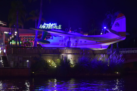 Orlando, Florida. October 19, 2018 Beatiful vintage plane in Citywalk Universal Studios at blue night.