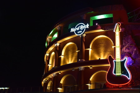 Orlando, Florida. October 19, 2018 Hard Rock Sign and Guitar on Roman Coliseum style building at Universal Studios Citywalk. Editöryel