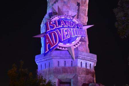 Orlando, Florida. October 19, 2018 Island of Adventure Sign on illuminated lighthouse at Universal Studios Citywalk. Redakční