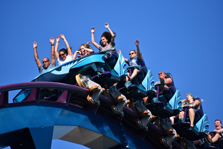 Orlando, Florida. October 19, 2018 People enjoying rollercoaster ride with their hands up at Seaworld Marine Theme Park. 에디토리얼