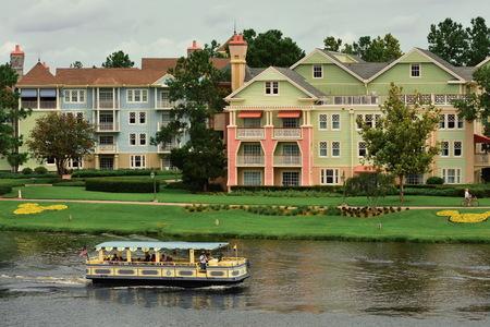 Orlando, Florida ; July 29, 2018 Colorful Victorian style buildings in Lake Buena Vista. Hotel Transfer Boat.