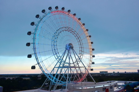 Orlando, Florida; August 1, 2018 Giant wheel, air view from International Drive. Beatiful sunset backround