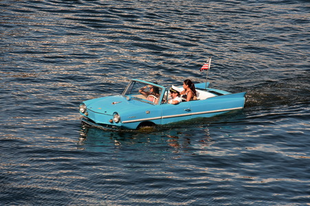 Orlando, Florida; August 24, 2018 Water Taxi, Blue Vintage Car, Funny People. Redakční
