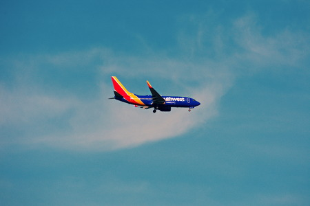 Orlando, Florida. September 5,2018. Airplane from Southwest Airlines, is landing at Orlando Airport on beatiful sky backround.