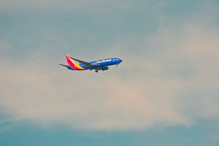 Orlando, Florida. September 5,2018. Airplane from Southwest Airlines, is landing at Orlando Airport on cloudy sky backround. Editorial