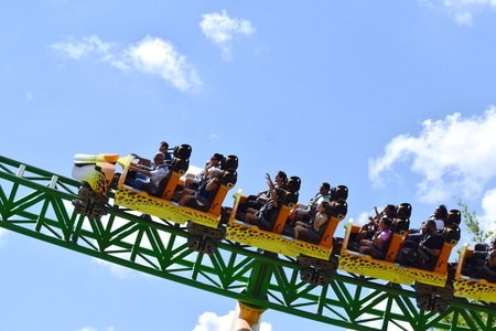 Tampa, Florida; September 29,2018. Bush Garden Park ride excited faces of people enyoing to Cheetah Hunt rollercoaster ride. Редакционное