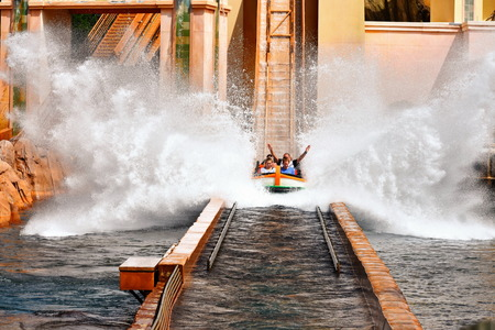 Orlando, Florida. September 29, 2018. Excited people enjoying Water Splash Attraction at Journey to Atlantis in Seaworld Theme Park.