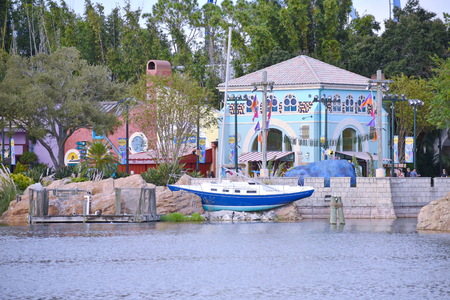 Orlando, Florida. October 19, 2018 Boat and colorful buildings african style at Seaworld Theme Park. Editorial