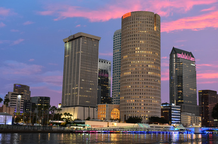 Tampa, Florida. October 06, 2018. Downtown Skyscrapers with colorful illuminated dockside on beatiful sunset.
