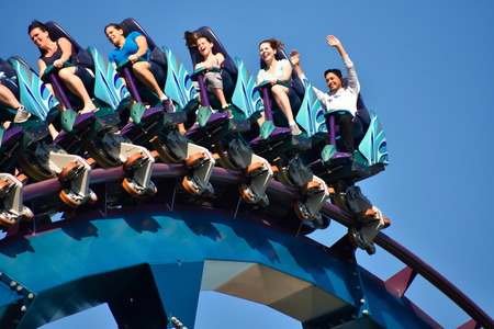 Orlando, Florida. October 19, 2018 Excited and scared people riding Mako rollercoaster at Seaworld Theme Park.