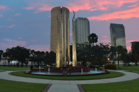 Tampa, Florida. October 06, 2018. Henry B Plant Park and Skyscrapers downtown buildings on colorful sunset.