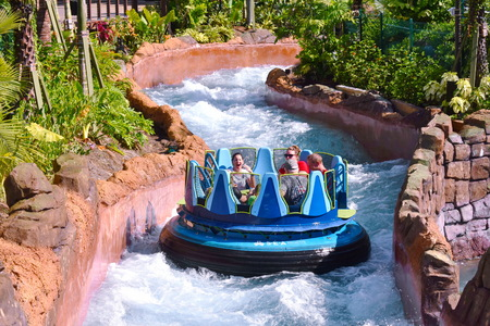 Orlando, Florida. October 19, 2018. People on board the raft, crossing river rapids at Seaworld Theme Park.