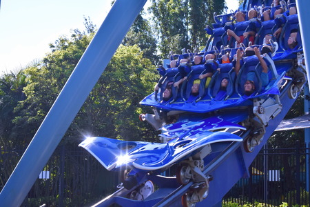 Orlando, Florida. October 19, 2018 People enjoying funny steel Manta Ray roller coaster at Seaworld Theme Park. Editorial