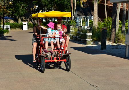 Orlando, Florida; November 02, 2018 Family with two beautiful girls, enjoying a ride on surrey bike in Lake Buena Vista area. Redakční