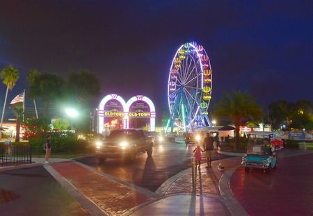 Orlando, Florida. November 02, 2018. Main entrance of Old Town with arches and colorful wheel in Kissimmee area. Editorial