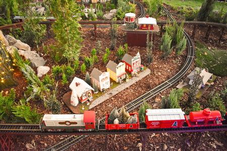 Orlando, Florida. November 22, 2018. Colorful Miniature train and nice small villa in International Drive area