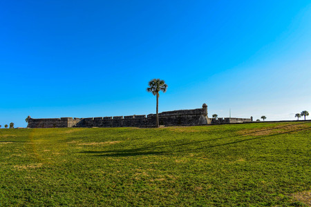 St. Augustine, Florida. January 26, 2019. Panoramic view of San Marcos Castle Fort and green meadow in Floridas Historic Coast.
