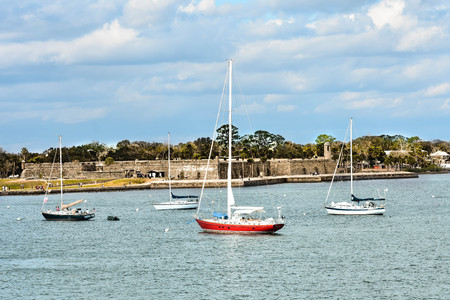 St. Augustine, Florida. January 26, 2019. Sailboat and San Marcos Fort Fort on lightblue sky background in Floridas Historic Coast. Editorial