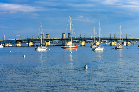 St. Augustine, Florida. January 26, 2019. Sailboats and Bridge of Lions on sunset sky background at Old Town Floridas Historic Coast (67) Editorial