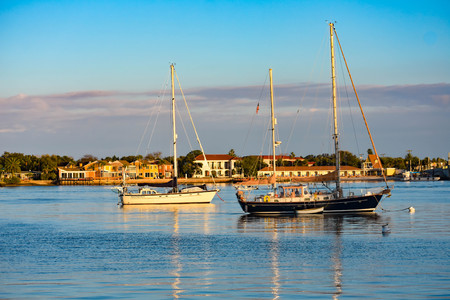St. Augustine, Florida. January 26, 2019. Sailboats and colorful houses on sunset sky background in Floridas Historic Coast. Editorial
