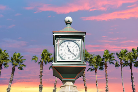 St. Augustine, Florida. January 26, 2019. Vintage watch on colorful sunset sky background in Floridas Historic Coast